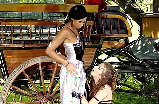 Classic period lesbians Juliette and Ashley have fun by the wagon
