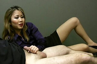 Lucky employee gets a handjob from lady boss